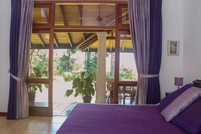 Jungle Tide Guest House Coot double room french doors open to beautiful veranda and garden view