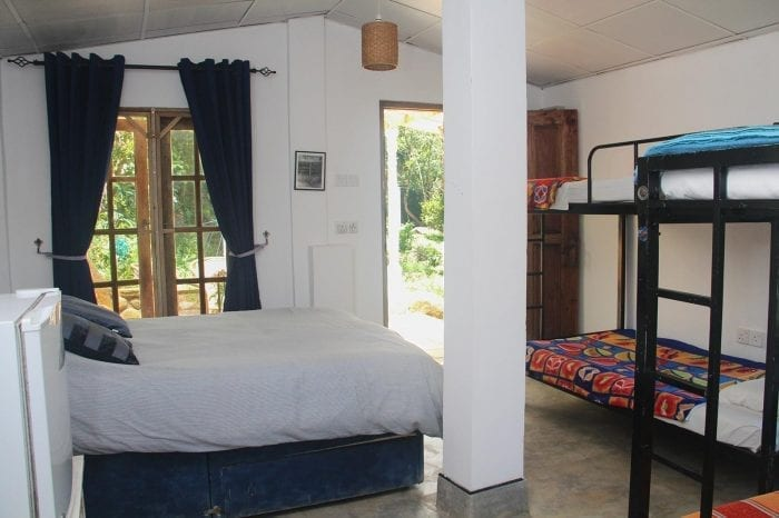 Jungle Tide Guest House Kingfisher Camping Barn with double bed and bunk beds perfect for families