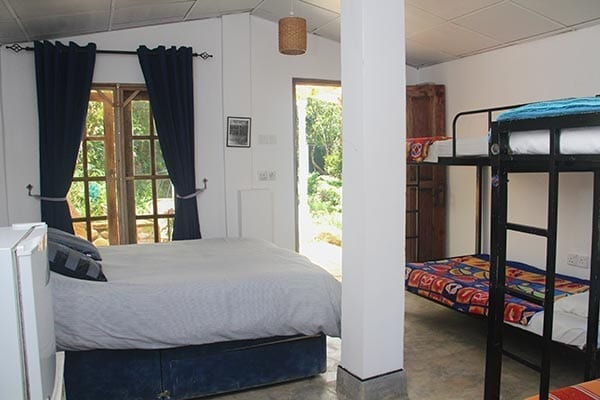 Hiring the whole guest house at Jungle Tide near Kandy includes the garden family room Kingfisher camping barn with double bed and bunk beds