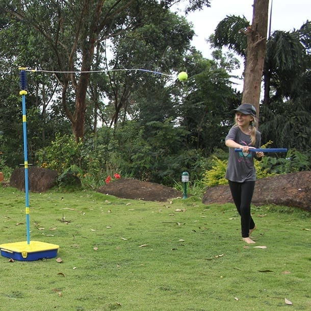 Child playing swingball on the lawn at Jungle Tide, the family friendly guest house near Kandy Sri Lanka