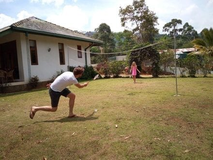 Jungle Tide Guest House near Kandy has a large lawn with a badminton net and rackets - being played by some guests