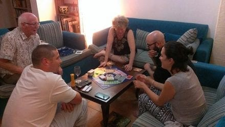 Jungle Tide Guest House has lots of indoor games for evenings and wet days - being enjoyed by a family