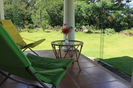 Relax on the veranda at Jungle Tide with views to the knuckles mountains